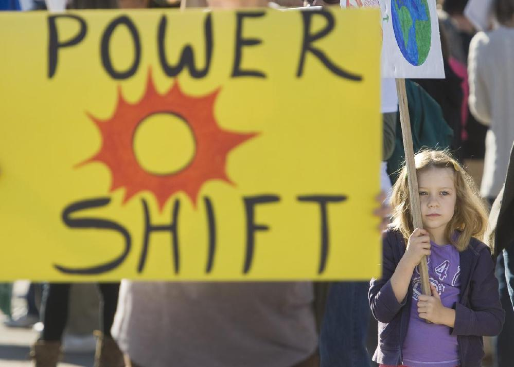 Child at a climate change mobilization in Irvine, CA is a young advocate for a clean-energy based future.