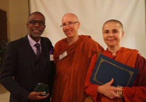 from left: Awardees Rev. Ken Chambers of West Side Missionary Baptist Church; Venerable Anandabodhi and Venerable Santacitta from Aloka Vihara Forest Monastery.